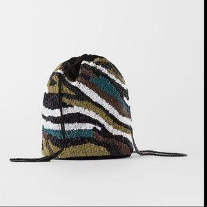 Zara beaded bucket bag with drawstring closure
